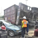 ‎Two die as 20-ft container falls on bus