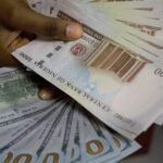 Again, Naira crashes, exchanges at N460/$