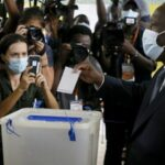 Amid opposition boycott, voters go to polls in Ivory Coast's controversial election